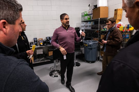 Dennis Zoma, of LIV Ferndale, tells Port Huron city councilmembers and planning commissioners about the system used to track marijuana products Tuesday, Jan. 21, 2020, in the processing room in the Ferndale dispensary.