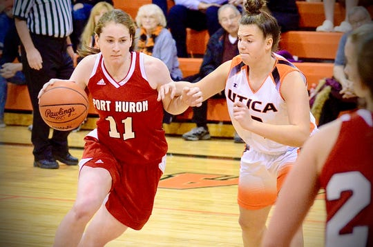 Port Huron's Emma Trombly drives through the paint against Utica in a Macomb Area Conference-Silver girls basketball game on Tuesday, Jan. 21, 2020.