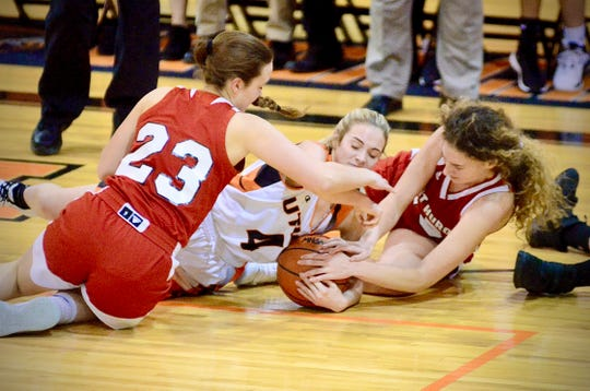 Port Huron's Morgan James and Madison Gilbert scrap for a loose ball against Utica in a Macomb Area Conference-Silver girls basketball game on Tuesday, Jan. 21, 2020.