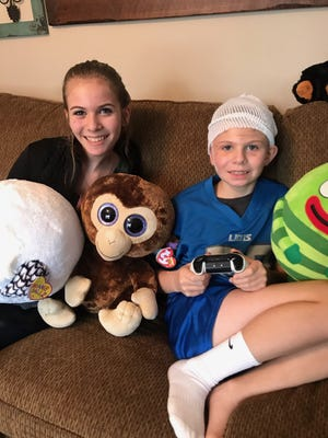 Wyatt Plewinski, 8, and his sister, Hailey