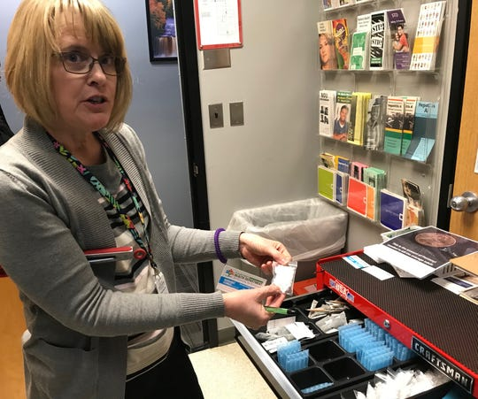 Margaret Sturgis, nursing supervisor with the St. Clair County Health Department, holds a baggie of cotton balls on Jan. 9, 2020. Clean needles and clean works supplies are given to participants in the free, confidential needle exchange program, run out of the county health department office.