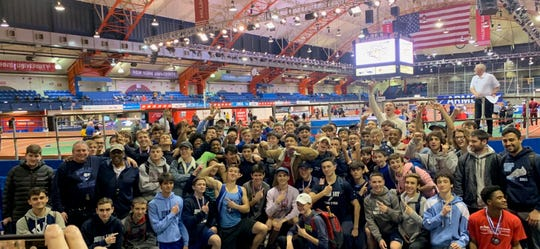 The John Jay-East Fishkill boys indoor track and field team poses in celebration after winning the League 1A title at The Armory last Sunday.