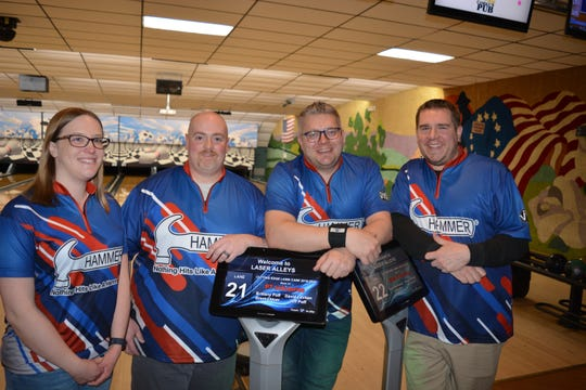 The Pure It Bowling team, from left, Kerry Smith, Dominic Mottillo, Jeff Smith and Kevin Bankrowski, rolled a 3,051 series at Laser Alleys, the highest in the nation this season for a three-man and one-woman team.