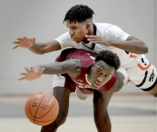 Central York's Taylor Wright-Rawls, top, and New Oxford's Abdul Janneh pursue a loose ball during basketball at Central Tuesday, January 21, 2020. Janneh was fouled on the play. New Oxford went on to win 69-66. Bill Kalina photo