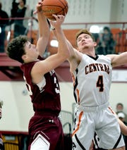 Central York's Gabe Guidinger and New Oxford's Connor Jenkins, left, vie for a rebound during basketball at Central Tuesday, January 21, 2020. New Oxford went on to win 69-66. Bill Kalina photo