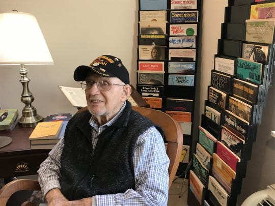 At 94, Carl Strassle still lives a life full of music, with racks of sheet music adorning his living room at Country Meadows at Leader Heights.