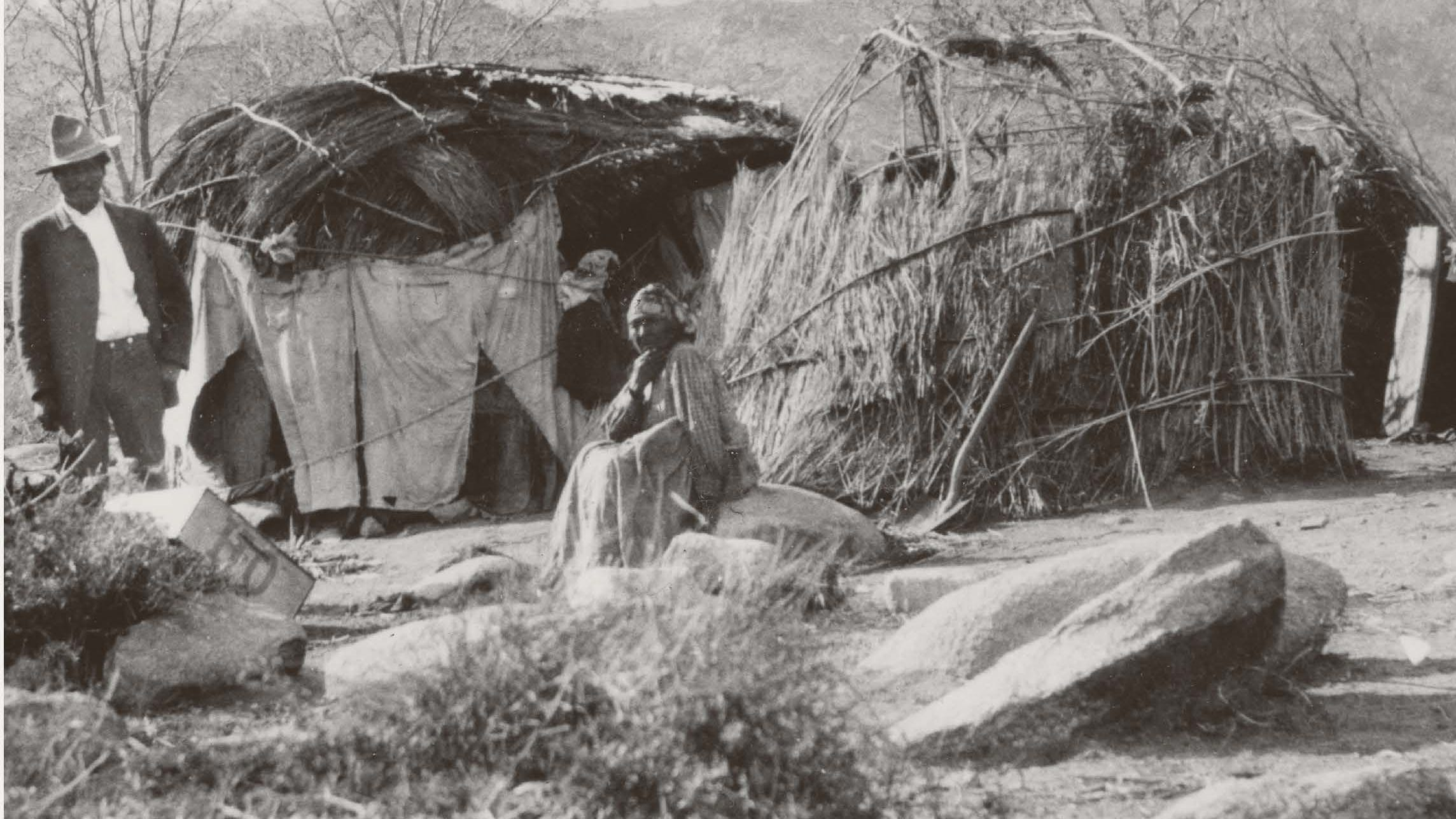 Parents of students who'd be taken to Stewart Indian School were not always allowed to see their children so they'd camp across the way at Clear Creek to get a glimpse of their children.  Parents are pictured camping at the creek in this undated photo.
