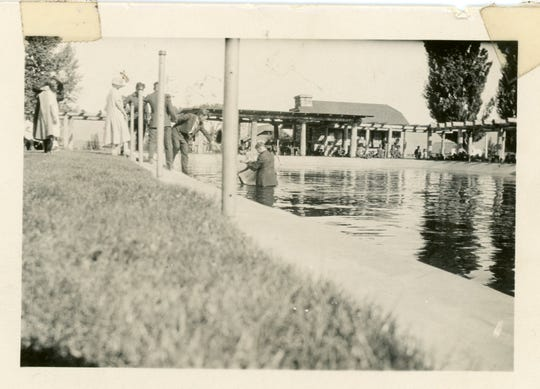 A baptism takes place in the Olympic-sized pool at Stewart Indian School in this undated picture.