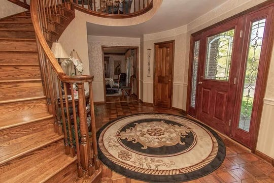 Located at 1235 S. Henley Road, the 4,929-square-foot house rests on a 1.25 acre wooded lot. Built in 1985, the home is listed at $449,000.