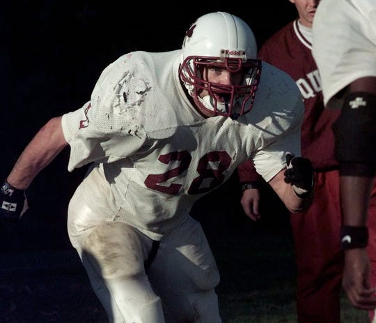 Tim Campe during an Aquinas football practice in 1997.