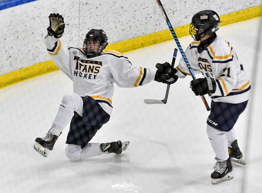 Webster Thomas' Cullen Hennessy, left, celebrates his goal with Zachary Wolfe during a regular season game against Penfield at the Webster Ice Arena, Tuesday, Jan. 21, 2020. Webster Thomas beat Penfield 2-1.
