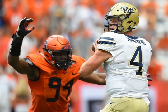 Syracuse edge rusher Alton Robinson puts the heat on Pitt quarterback Max Browne.
