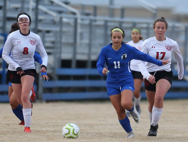 San Angelo Lake View's Jazymyne Flores, 11,  chases a loose ball during a match against Lubbock-Cooper at Lake View Stadium on Tuesday, Jan. 21, 2020.