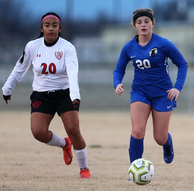 San Angelo Lake View's Faith Miller, right, chases a loose ball during a match against Lubbock-Cooper at Lake View Stadium on Tuesday, Jan. 21, 2020.