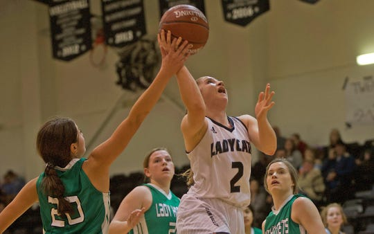Kirstyn Greebon, center, lays the ball in for Water Valley during a game against Blackwell on Tuesday, Jan. 21, 2020.