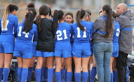 San Angelo Lake View High School head girls soccer coach Henry Gonzales talks to the Maidens during a match against Lubbock-Cooper at Lake View Stadium on Tuesday, Jan. 21, 2020.