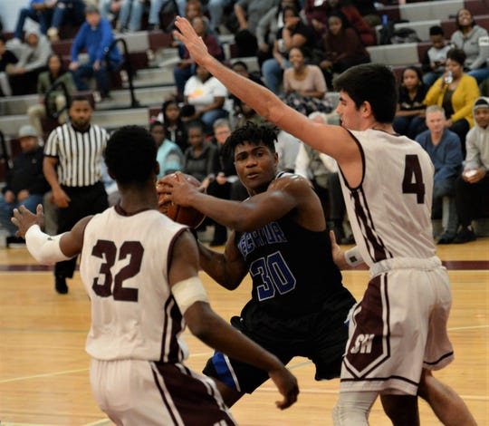 Stephen Decatur forward DaCameron McAfee looks to pass on Tuesday, Jan. 21, 2020.