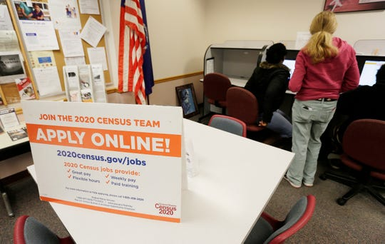 A sign inside Wisconsin Job Center has information on. how to apply for the short term census positions, Wednesday, January 22, 2020, in Sheboygan, Wis.