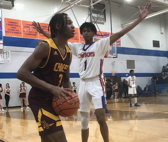 Natchitoches Central guard Devonta Snow prepares to pass past Southwood's Christian Caldwell Tuesday at Southwood.