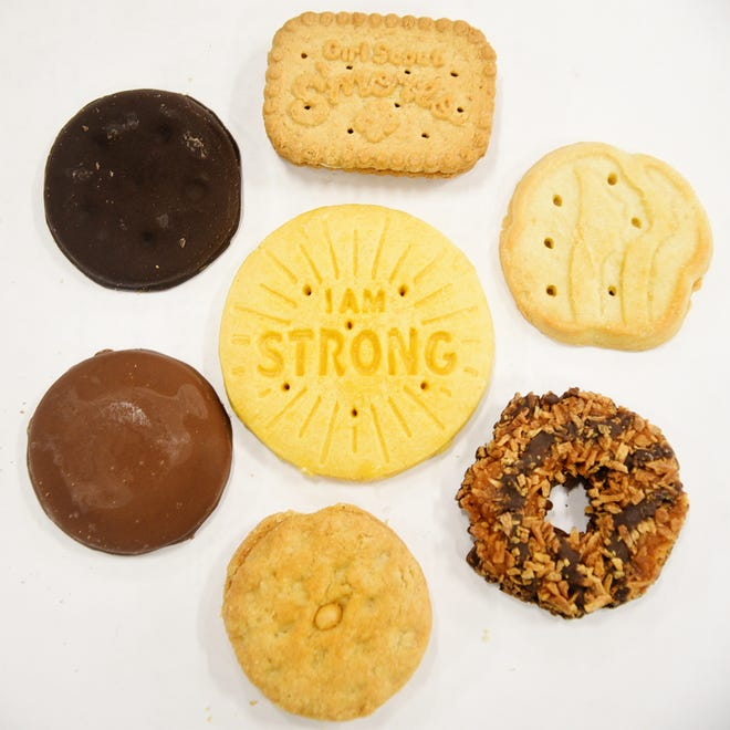 The Girl Scout cookies (clockwise starting at top) Girl Scout S'mores, Trefoils, Samoas, Do-si-dos, Tagalongs, Thin Mints and the new Girl Scout cookie is the Lemon-Ups (center).