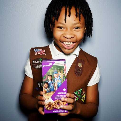"""Girl Scout Tatum Davis with Samoas cookies. """"I learned how to be a sister to every Girl Scout."""""""