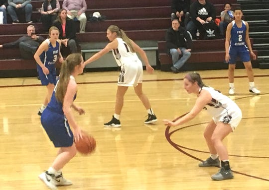 Fort Defiance held off Stuarts Draft Tuesday night in a Shenandoah District girls basketball game.