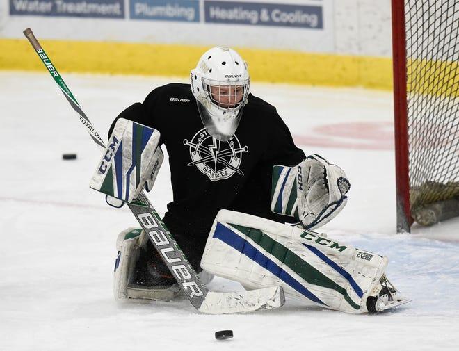 Sartell/Sauk Rapids senior goalie Chloe Stockinger makes a save at practice Wednesday, Jan. 22, 2020, at Bernick's Arena.