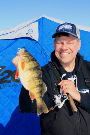 Tourism Director Joe Henry shows off a big Lake of the Woods perch.