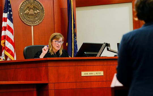 FILE - In this Nov. 19, 2019, file photo, Judge Kara Pettit, center, speaks in court during deliberations in a case where defendant Tilli Buchanan was charged with criminal lewdness, in Salt Lake City. The judge refused on Tuesday, Jan. 21, 2020, to overturn part of Utah's lewdness law in a blow to Buchanan who's fighting criminal charges after her stepchildren saw her topless in her own home. Pettit sided with prosecutors who argued that lewdness is commonly understood to include women's breasts in American society, the Salt Lake Tribune reported. (Leah Hogsten/The Salt Lake Tribune via AP, File)