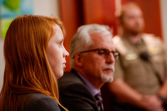 FILE - In this Nov. 19, 2019, file photo, Tilli Buchanan, left, sits in court with Randy Richards, right, her attorney, during deliberations in a case where Buchanan was charged with criminal lewdness involving a child, in Salt Lake City. Judge Kara Pettit refused on Tuesday, Jan. 21, 2020, to overturn part of Utah's lewdness law in a blow to Buchanan who's fighting criminal charges after her stepchildren saw her topless in her own home. Pettit sided with prosecutors who argued that lewdness is commonly understood to include women's breasts in American society, the Salt Lake Tribune reported. (Leah Hogsten/The Salt Lake Tribune via AP, File)