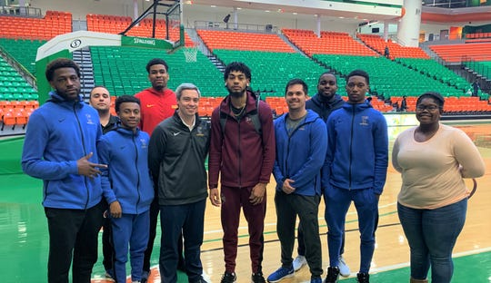 TCC men's basketball coaching staff came to FAMU to support Deven Palmer who now competes for North Carolina Central. From left to right: Tariq Silver (player), assistant coach Noah Croak (back row), Rifen Miguel (back row), Malique Calixte, Zach Settembre (head coach), Deven Palmer, Ben Mandelbaum (assistant coach), Jordan Talley (assistant coach), El Ellis (player) and Leah Hutchins.