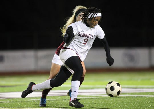 Florida High senior Janae Scott dribbles through the midfield as Chiles' girls soccer team beat Florida High 7-0 on Jan. 21, 2020.