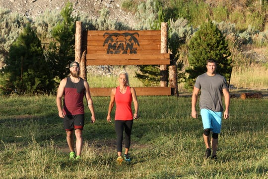 """Matt Roberts, 32, of Fellsmere (right) and his competitors on Discovery's """"Man Vs. Bear."""" Roberts' episode airs 8 p.m. Saturday."""