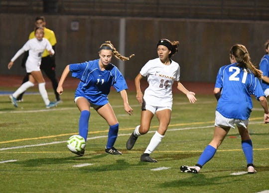 Westlake defender Lola Hansen sidesteps Oxnard winger Julie Marcelo during a scrimmage last month at Westlake High. While Westlake is in the hunt in the Marmonte League, Oxnard has been the front-runner all season in the Pacific View League.