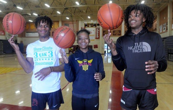 Oxnard High's Stacy Johnson, 18, left, sister Mika Jarrett, 14, and brother Kai Johnson, 16, are key players on powerhouse boys and girls basketball teams.