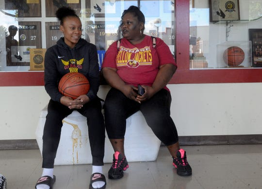 Mika Jarrett, 14, and her mother Kika Johnson wait for a team practice at Oxnard High. Jarrett and her brothers Stacy and Kai Johnson have been leaders for the talented Oxnard basketball programs.