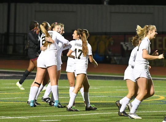 The Oak Park High girls soccer team celebrates after scoring a goal in the Eagles' 4-0 win at Oaks Christian on Dec. 11. Oak Park  is ranked No. 4 in Division 3.