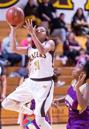 Golden West's Indya Smith shoots against Lemoore in girls basketball on Tuesday, January 21, 2020. She became the school's the all-time leading scorer, breaking Jess McElree's 20-year-old record of 1,506.