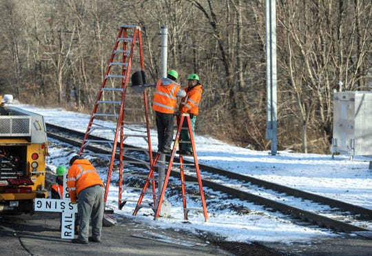 Metro-North Railroad workers repair the gates at Washington Ave. in Sloatsburg on Wednesday, January 22, 2020.  A tractor trailer was struck by a Metro-North commuter train at the crossing on Tuesday evening.