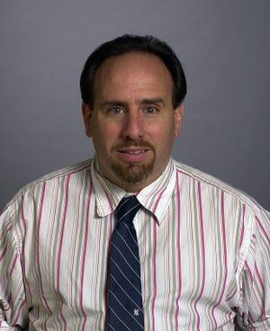 Croton-Harmon head coach Sam Occhipinti, pictured here in a 2003 file photo. Occhipinti will retire at the end of the season.