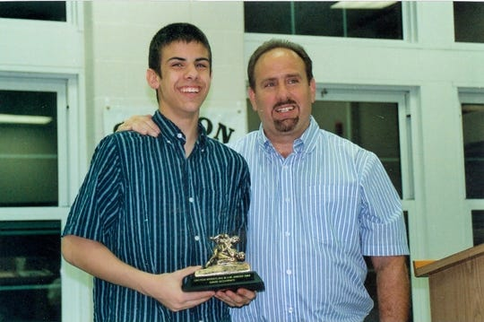Sam Occhipinti photographed with his son, after David Occhipinti won a high school wrestling award in 2010.