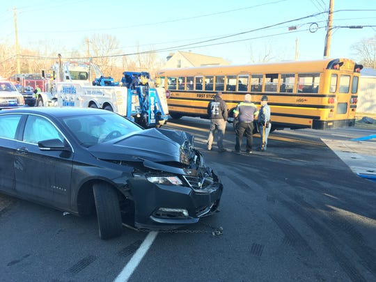 A two-vehicle crash involving a school bus injuries a woman and four kids while closingRed Lion Road (Del. 71) in the area of Del. 7in Bear Wednesday afternoon.