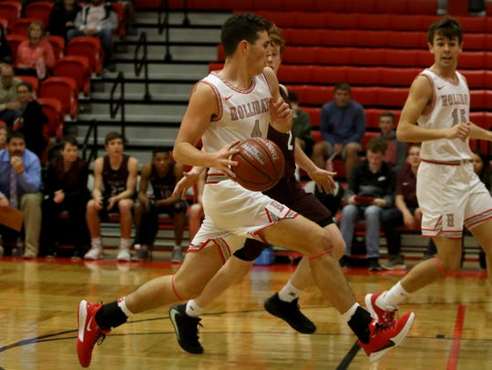 Holliday's Crae Jackson drives to the basket against Bowie Tuesday, Jan. 21, 2020, in Holliday.