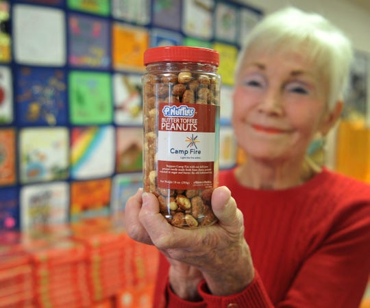 Camp Fire of North Texas, executive director, Bettye Ricks displays one of this year's best selling Camp Fire products, butter toffee peanuts.