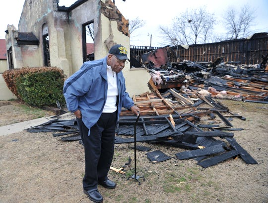 New Jerusalem Baptist Church pastor, Reverend, Angus Thompson surveys the damage done to his church's annex Wednesday afternoon. The Wichita Falls Fire Department responded to a three-alarm fire at that location earlier this month.
