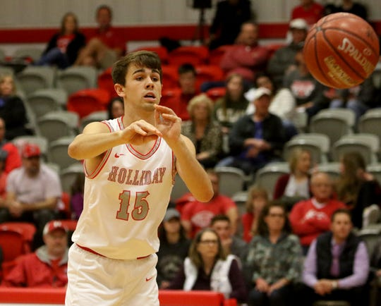 Holliday's Tucker Strealy passes in the game against Bowie Tuesday, Jan. 21, 2020, in Holliday.