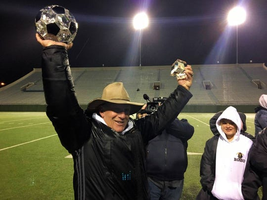Rider girls soccer coach Carl Wierseme holds up a crystal soccer ball awarded to him by his players and fellow Rider coaches following the Lady Raiders 2-1 victory against Denton Braswell on Tuesday, Jan. 21, 2020. It was Wiersema's 500th career victory, achieved on his 59th birthday.