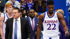 Jan 21, 2020; Lawrence, Kansas, USA; Kansas Jayhawks head coach Bill Self and forward Silvio De Sousa (22) walk off the court after a brawl broke at the end of the game against the Kansas State Wildcats at Allen Fieldhouse. Mandatory Credit: Jay Biggerstaff-USA TODAY Sports