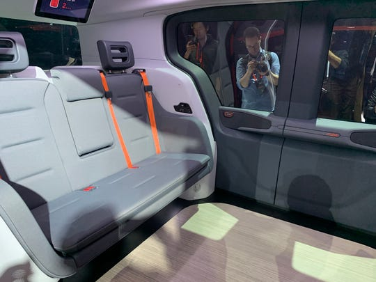 The interior of the Cruise Origin, the GM company's first purpose built autonomous EV meant for ride hailing, features seating for six, who sit facing each other.