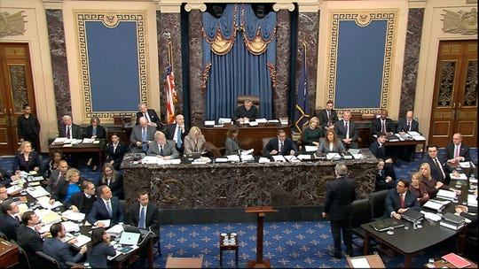 In this image from video, White House counsel Pat Cipollone, stands and waits to be recognized by presiding officer Supreme Court Chief Justice John Roberts during the impeachment trial against President Donald Trump in the Senate at the U.S. Capitol in Washington, Tuesday, Jan. 21, 2020. (Senate Television via AP) ORG XMIT: DCJE108